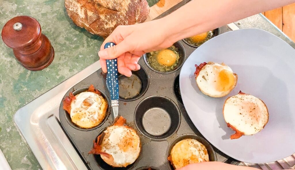 spooning the muffins out of the pan is easy if you pre butter the muffins tins