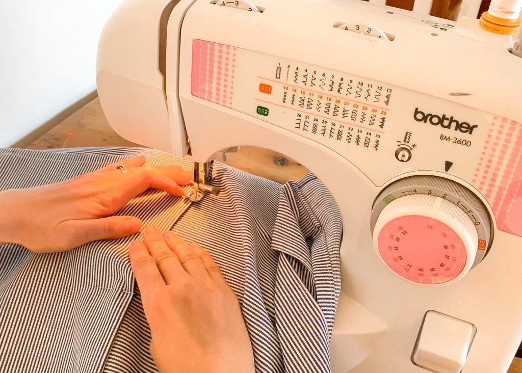 Sewing around the edge of the pocket on the half apron